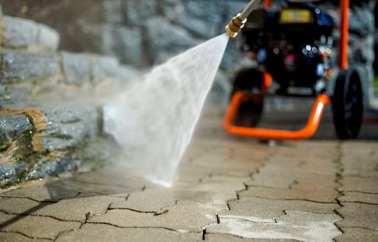 pressure washer washing stone patio
